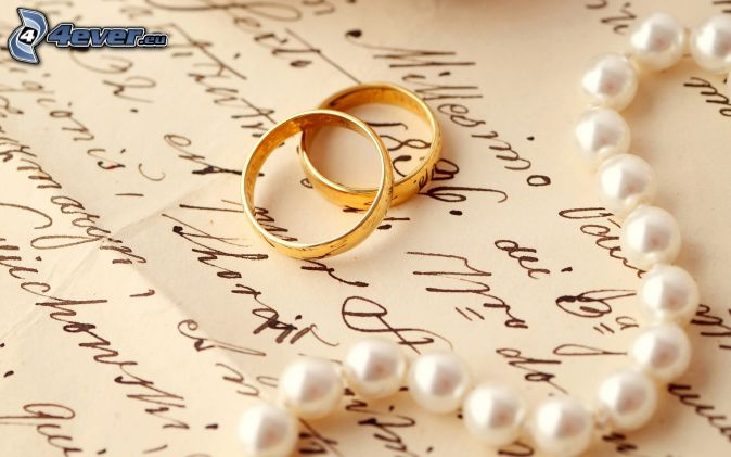 wedding rings, pearl necklace, text