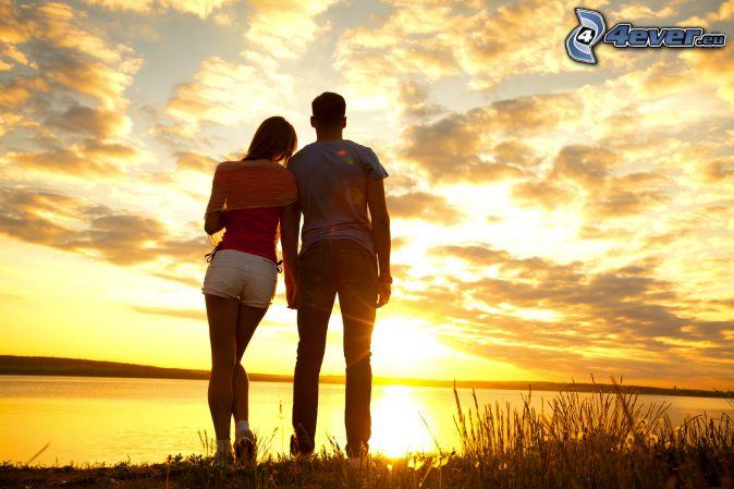 couple, sunset at the lake