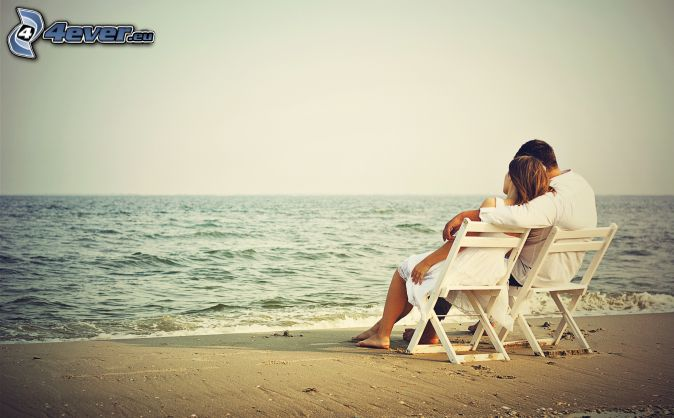 couple by the sea, open sea, chairs