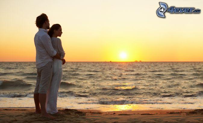 couple by the sea, sunset, sandy beach