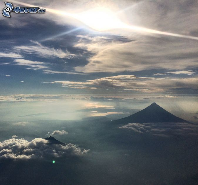 Mount Mayon, Philippines, over the clouds, sun