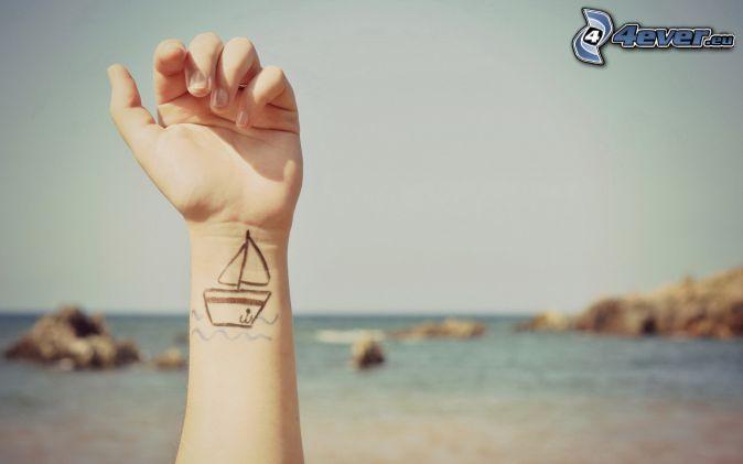 hand, tattoo, open sea