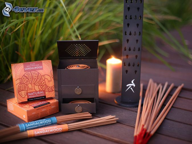 incense sticks, candle, blades of grass