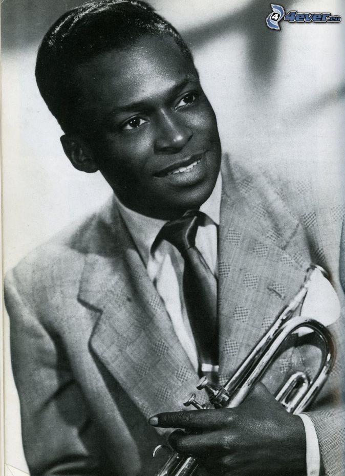 Miles Davis, smile, man in suit, trumpet