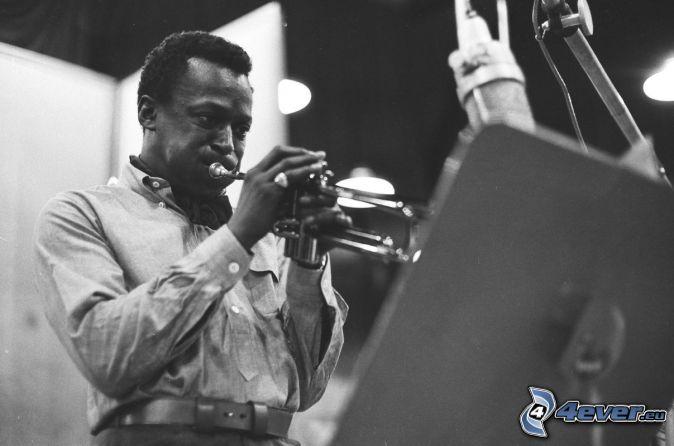 Miles Davis, trumpet playing, black and white photo