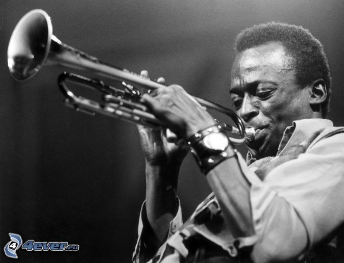 Miles Davis, trumpet playing, black and white photo
