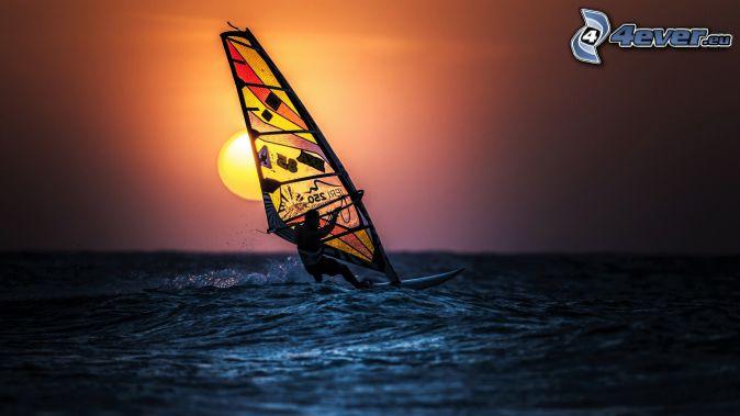 windsurfing, sunset over the sea