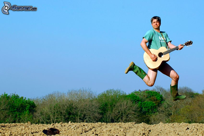 man with guitar, jump, forest