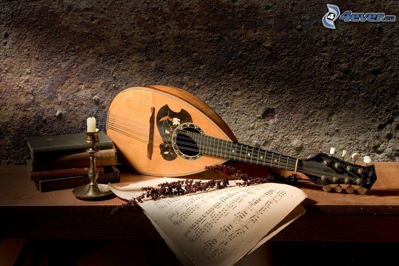 mandolin, sheet of music, old books, candlestick, lavender