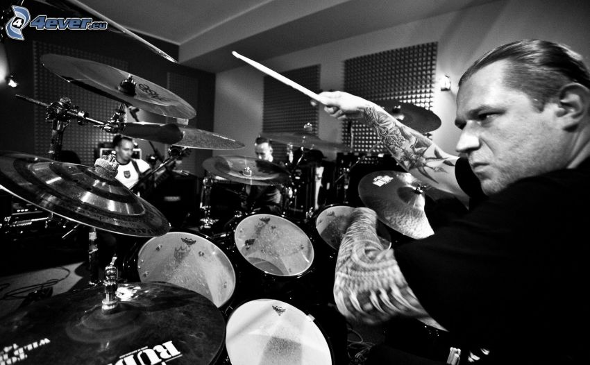 playing drums, black and white photo
