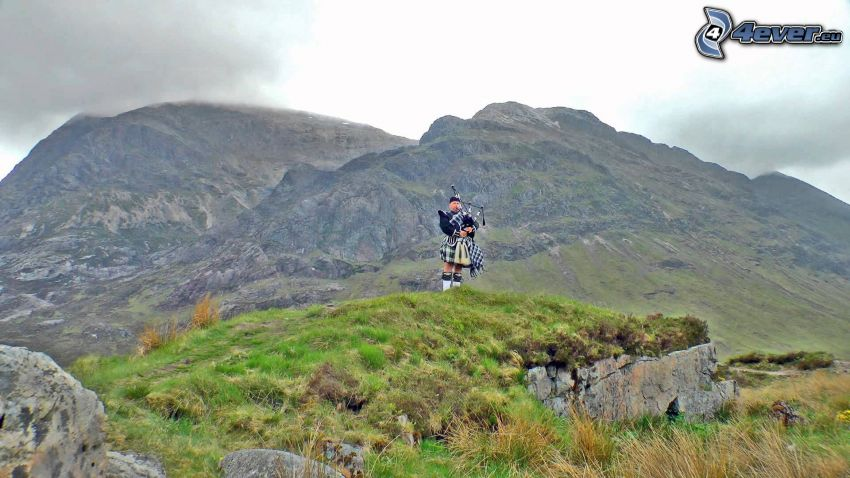 playing the bagpipes, rocky hills