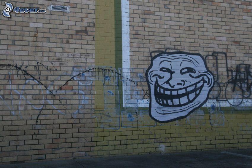 troll face, graffiti, brick wall