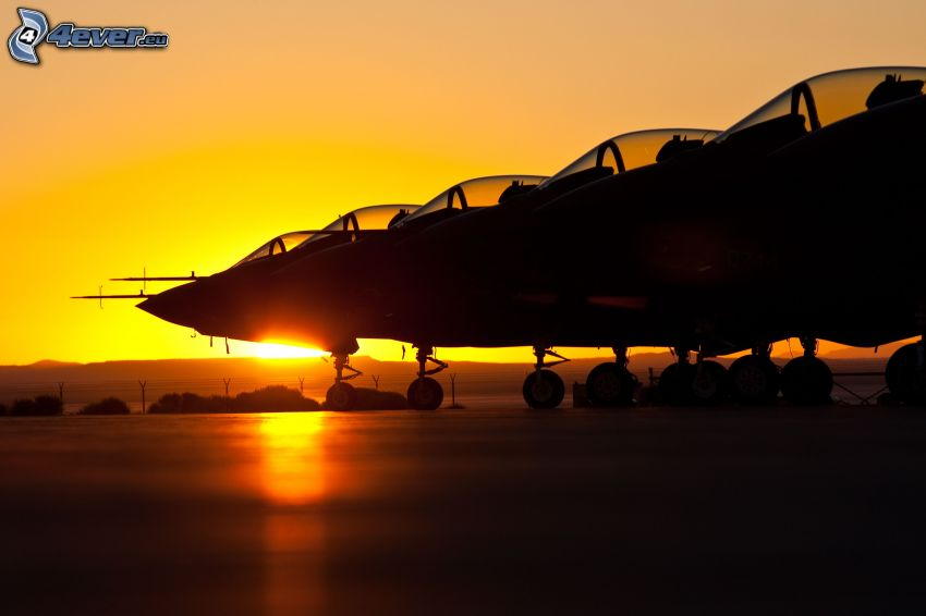 silhouettes of jet fighters, sunset