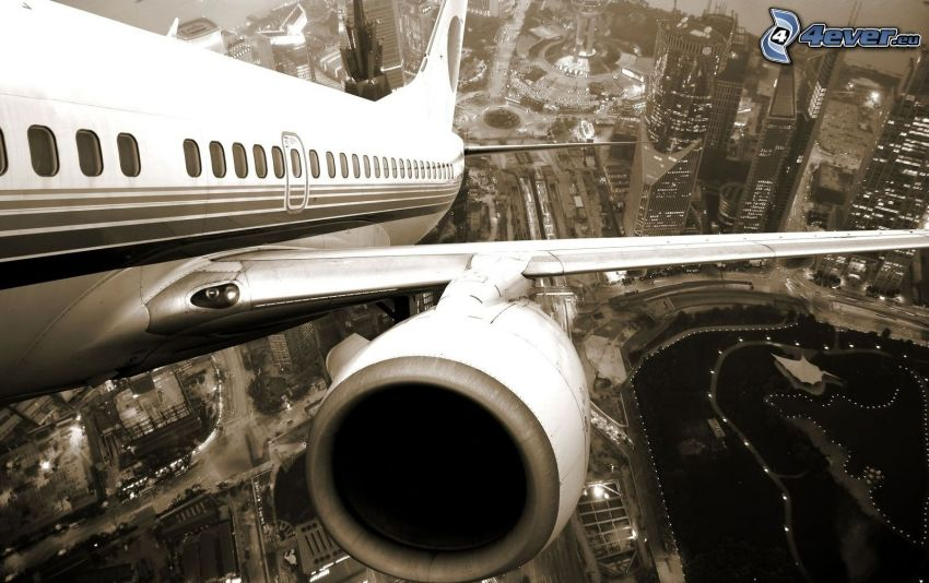 aircraft, jet engine, city, skyscrapers