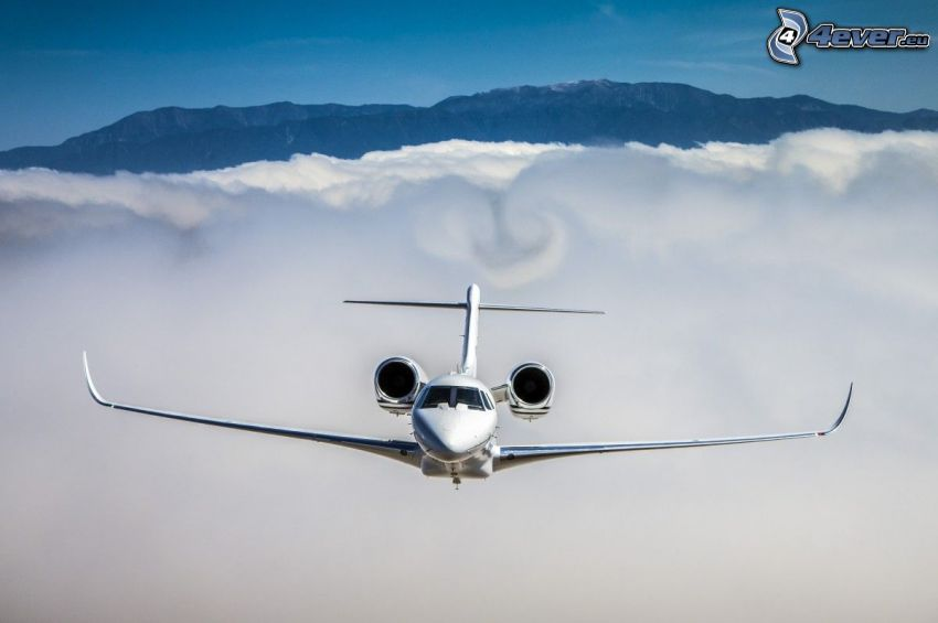 Citation X - Cessna, over the clouds, mountain