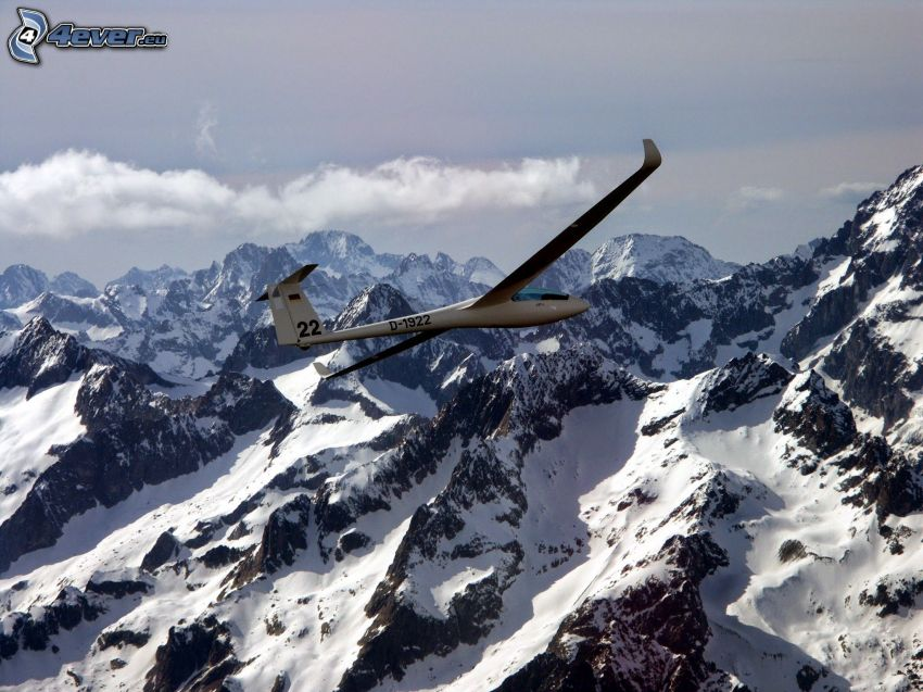 glider, snowy mountains