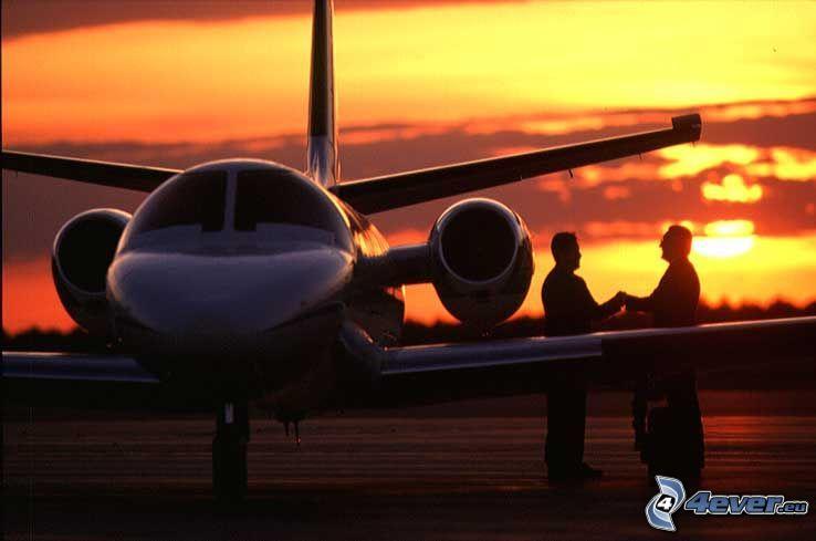 private jet, sunset