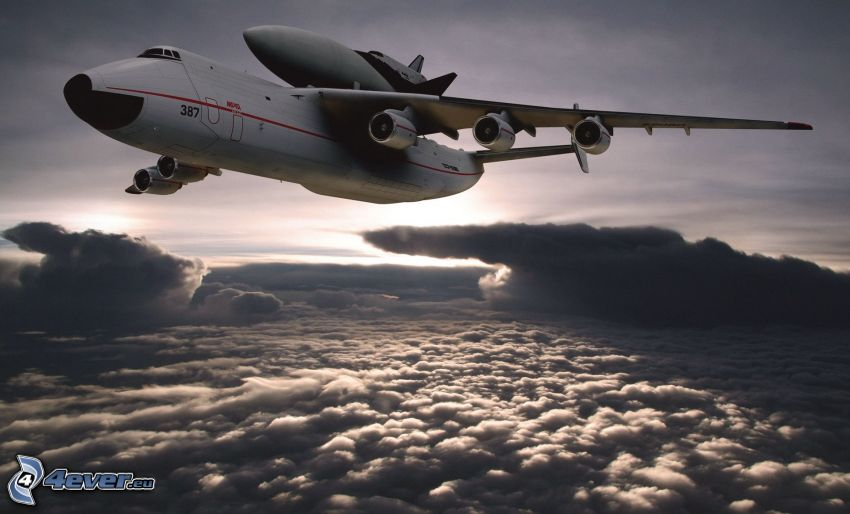 transporting space shuttle, aircraft, over the clouds