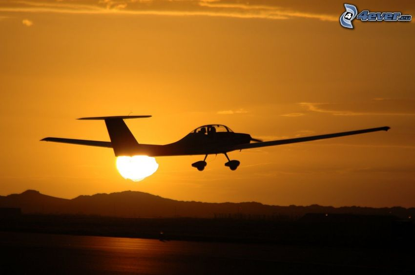 VGS Cadet, small sport aircraft, take off at sunset, orange sky