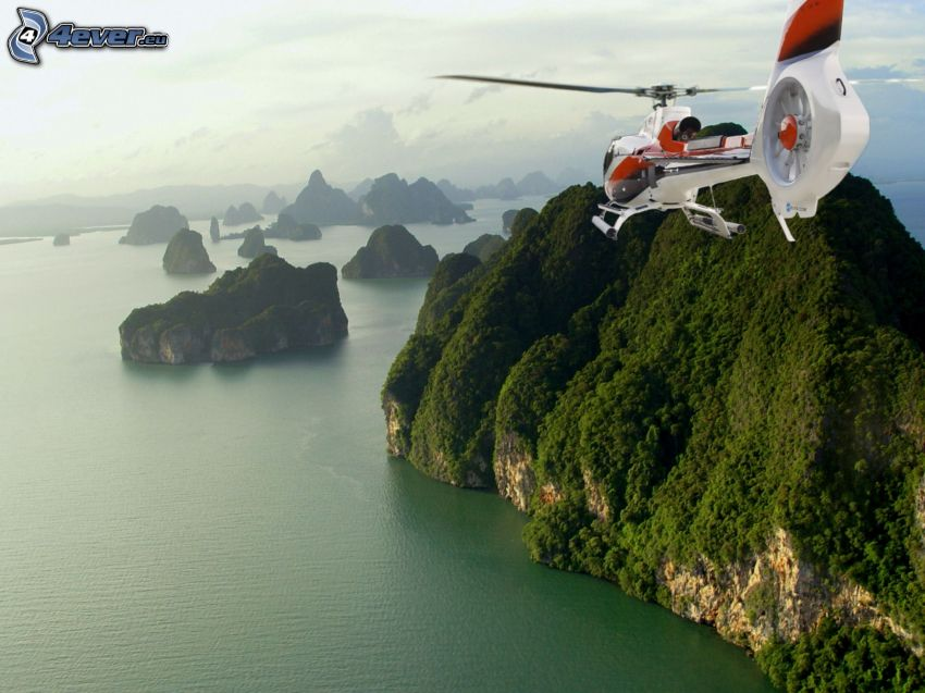 helicopter, rocks in the sea