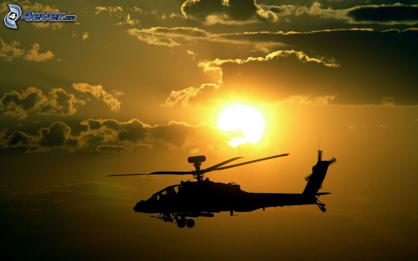 silhouette of helicopter, sun, clouds