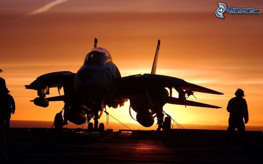 silhouette of the aircraft, sunset
