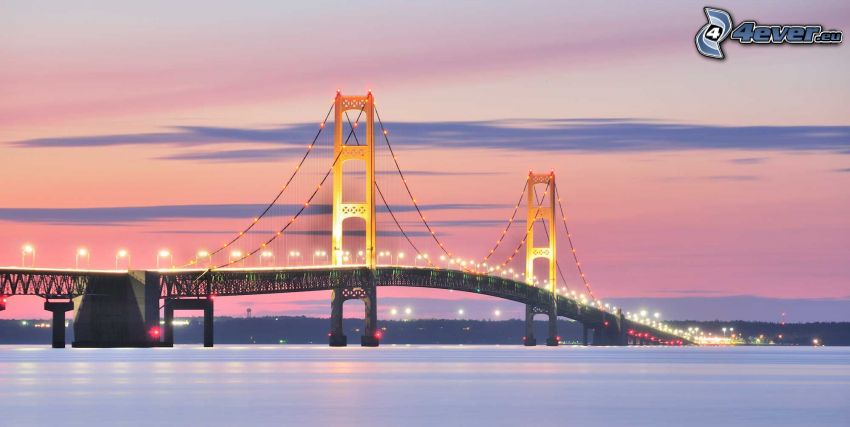 Mackinac Bridge, orange sky, lighted bridge
