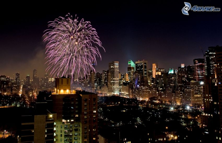 fireworks over the city, night in New York, USA