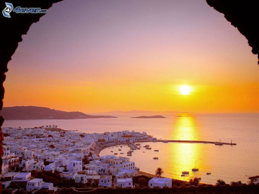 Greece, sunset over the sea, houses