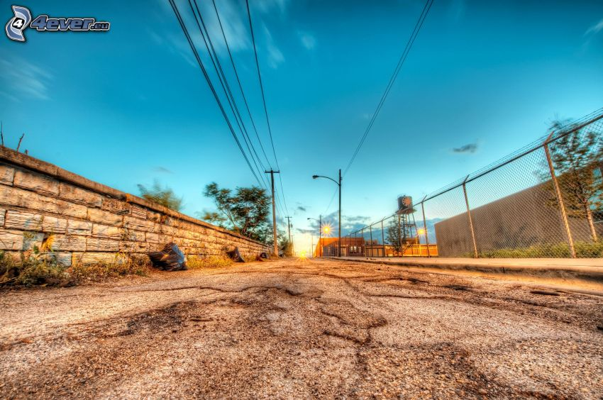 road, fence, power lines, wall, sunset in the city, sky, HDR