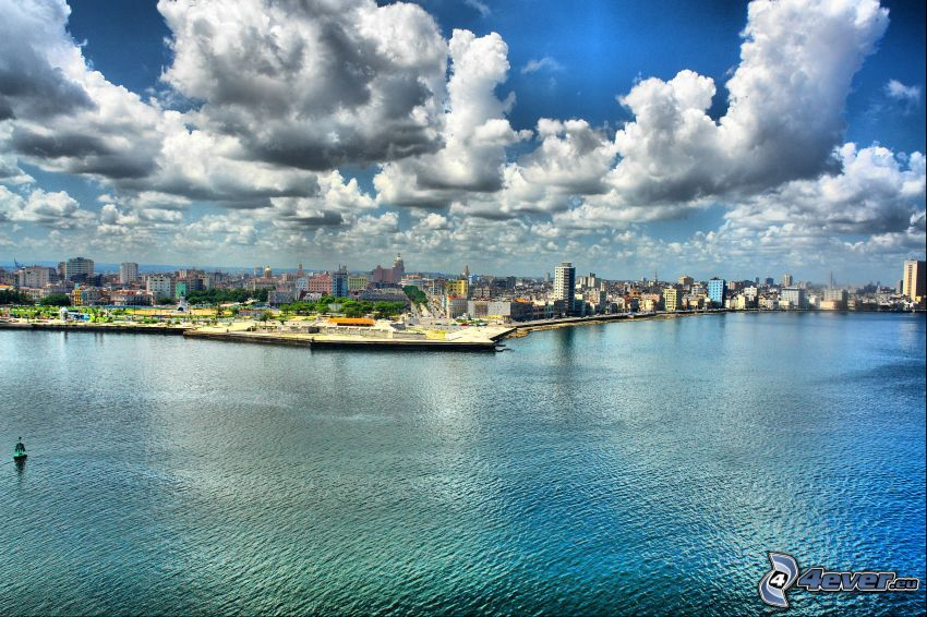 view of the city, sea, clouds