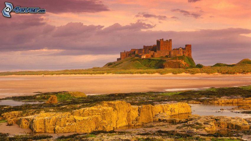 Bamburgh castle, sandy beach, after sunset