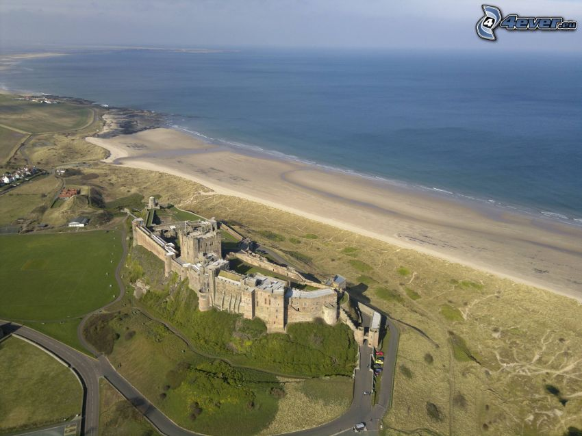 Bamburgh castle, sandy beach, open sea