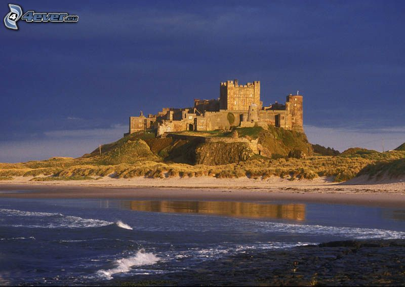 Bamburgh castle, sandy beach, sea