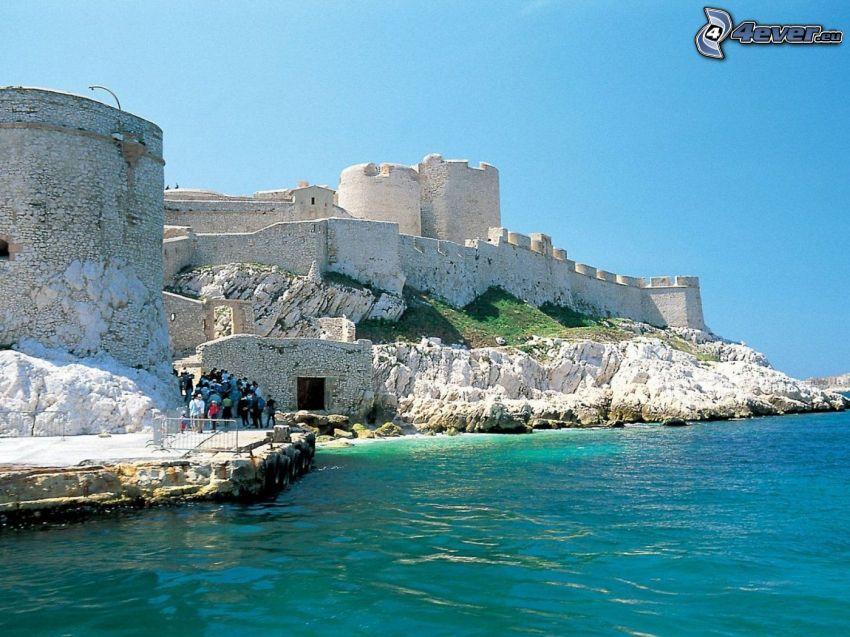 Château d'If, rocky shores, tourists