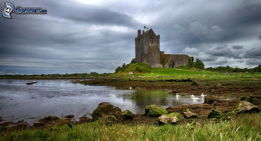 Dunguaire Castle, lake, dark clouds
