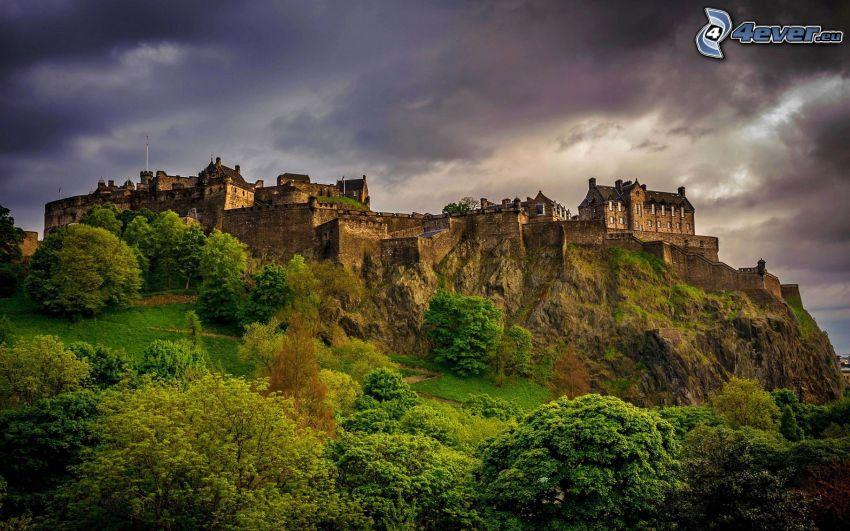 Edinburgh Castle, greenery, dark clouds