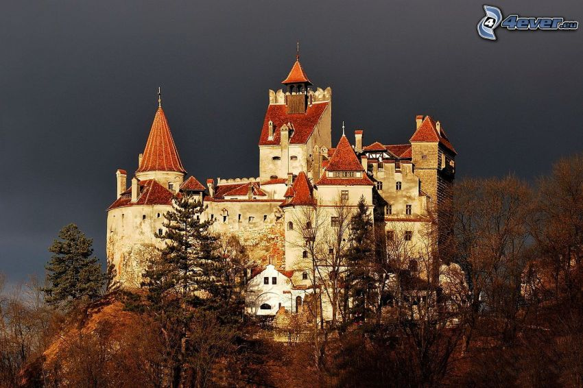 Hunyad, castle, autumn trees, dark sky