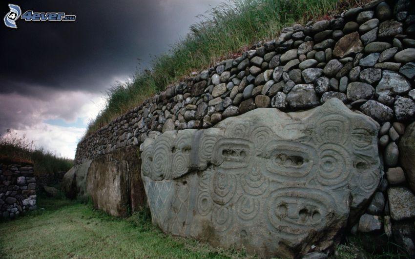 stone wall, ornaments, grass