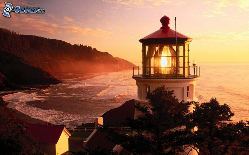 lighthouse, beach at sunset, the view of the sea