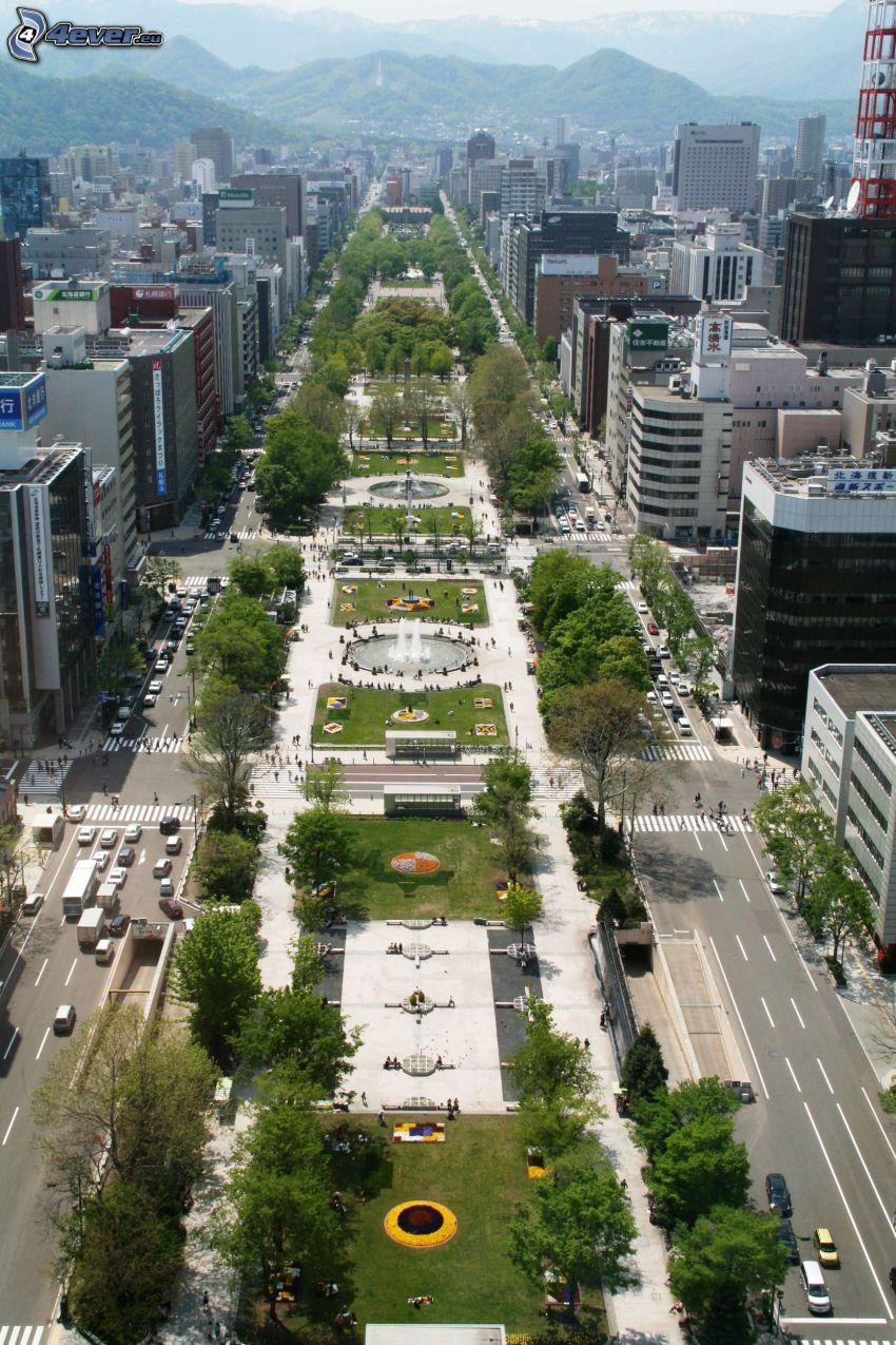 Odori Park, Sapporo, skyscrapers, mountain