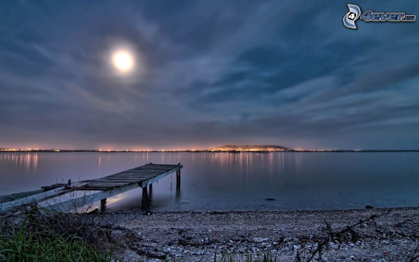 wooden pier, sea, evening city, moon