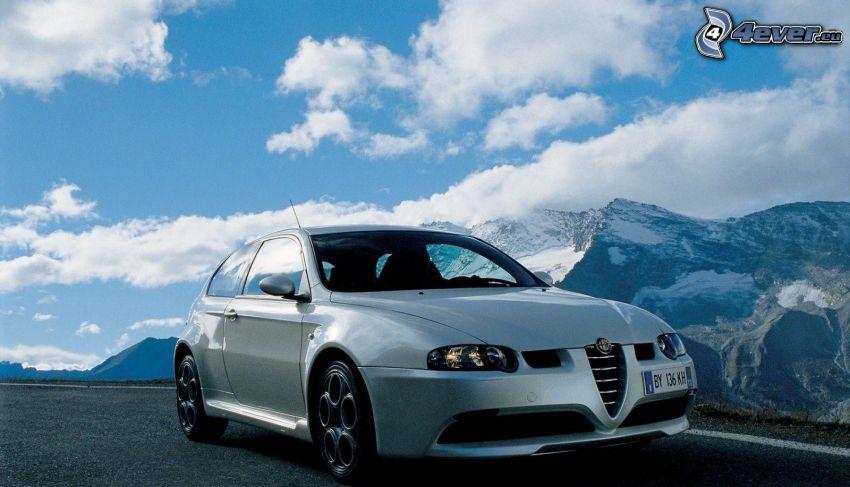 Alfa Romeo, rocky mountains, clouds