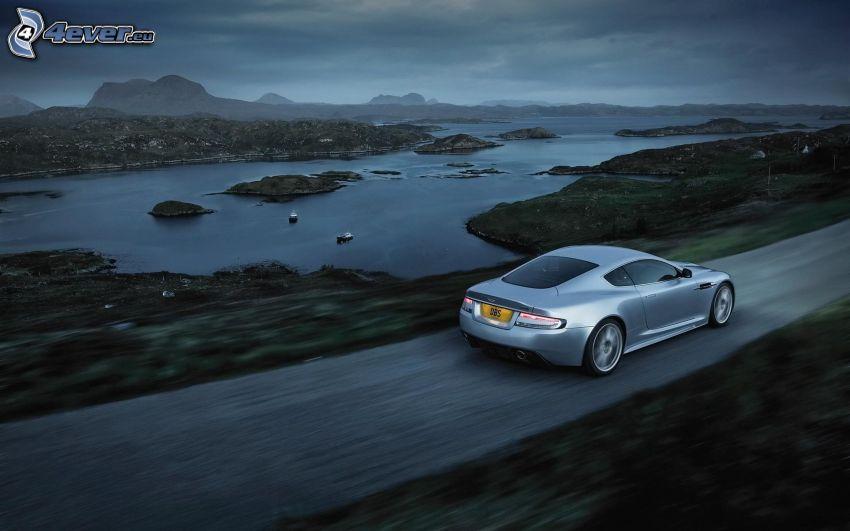 Aston Martin DBS, speed, night, rocky shores