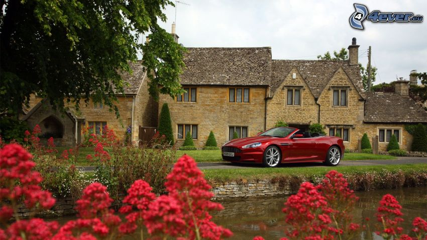 Aston Martin DBS, stone houses, stream, red flowers, english countryside