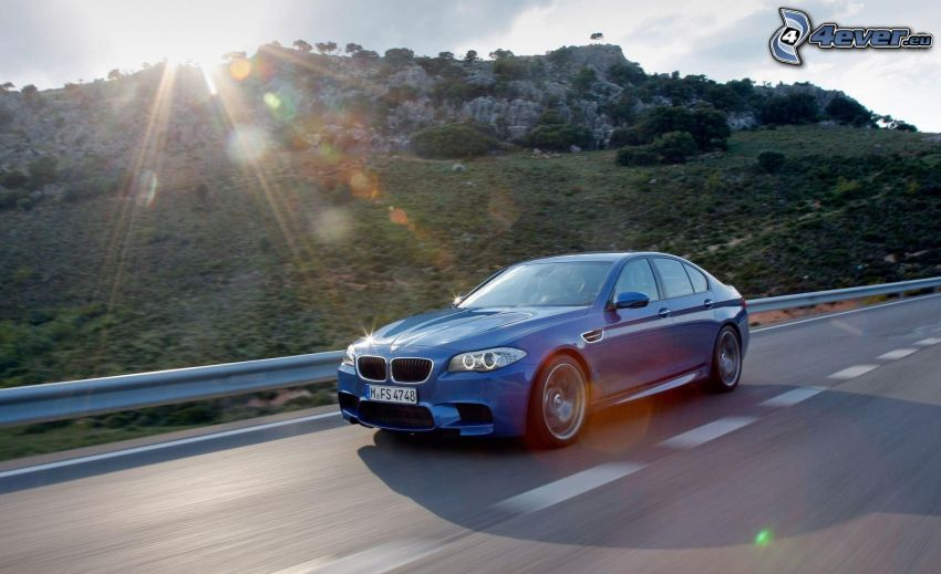 BMW M5, road, speed, sunbeams, rocky hill