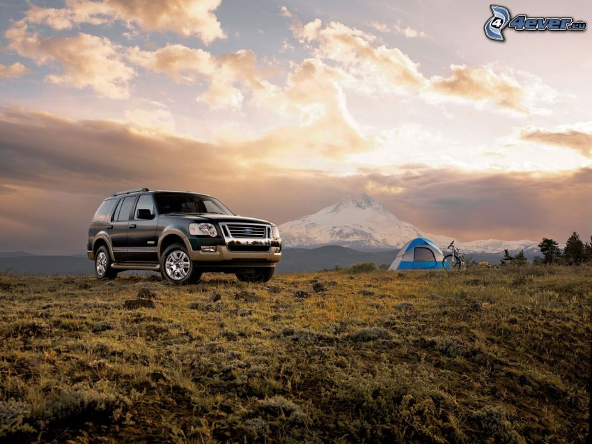 Ford Explorer, tent, bicycle, snowy hill, clouds