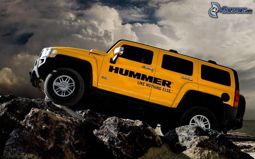 Hummer H3, rocks, terrain, clouds