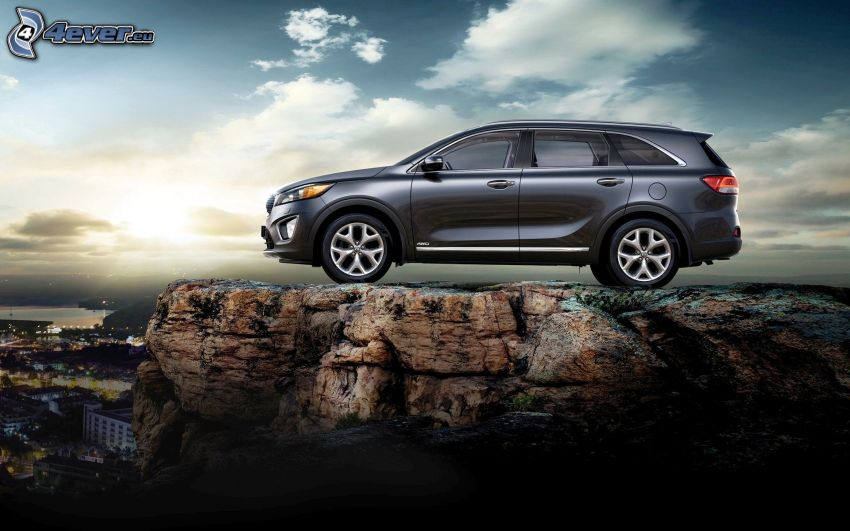 Kia Sorento, cliff, sun behind the clouds