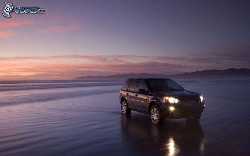 Land Rover Freelander, beach, evening sky